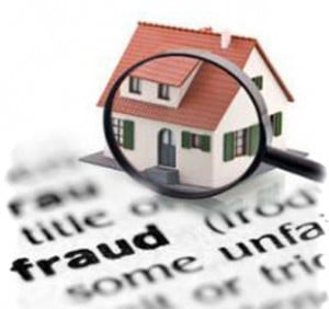 Magnifying glass looking at house on paper saying fraud