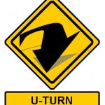 Road sign sayng u-turn