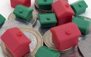 Monopoly houses on coins