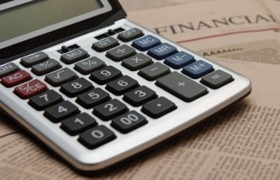Calculator on financial newspaper