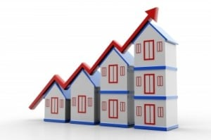 arrow up graph of stacking houses