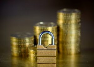 Padlock in front of coins