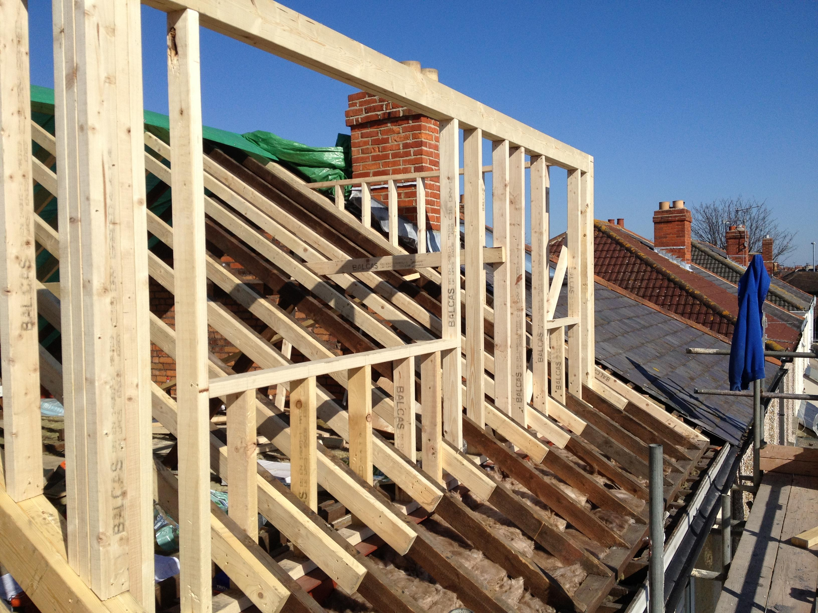 To buy a house with old uncertified loft conversion?