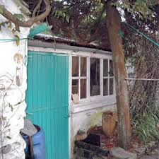 Neighbour's outbuilding within my boundary in state of disrepair?