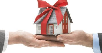 How do I transfer ownership of my rental house into my wife's name?