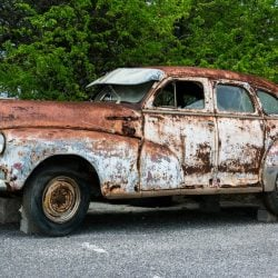 End of tenancy and derelict car on driveway
