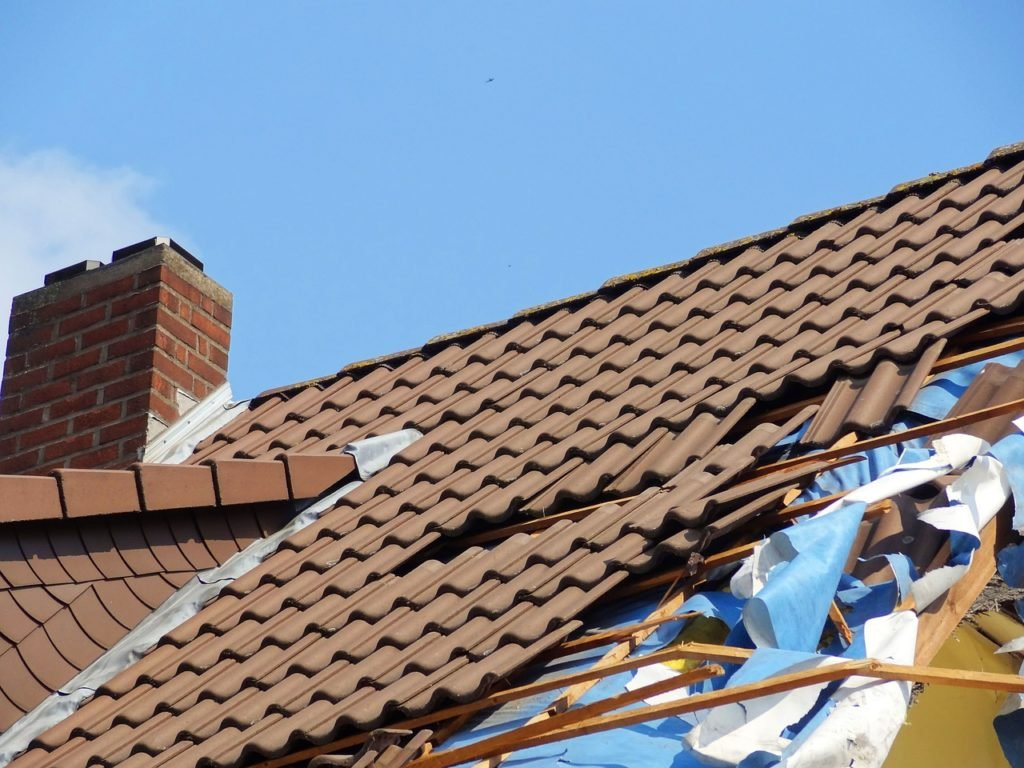 Freeholder refusing responsibility for roof repairs?
